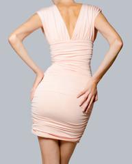 Beautiful fashion model in pink dress