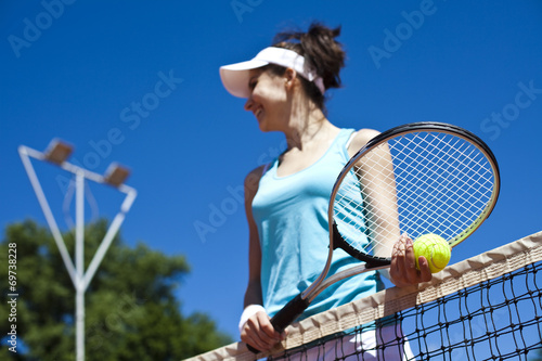 Woman playing tennis in summer t-shirt