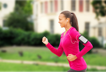 smiling young woman running outdoors