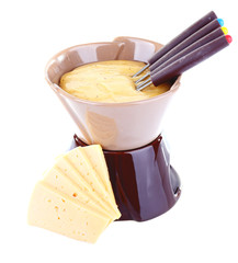 Fondue and slices of cheese isolated on white