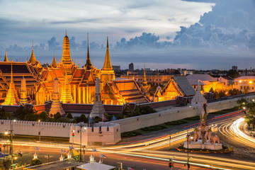 Grand palace at twilight with light from traffic in Bangkok, Tha