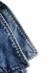 Denim indigo blue jeans jacket collar, isolated macro closeup