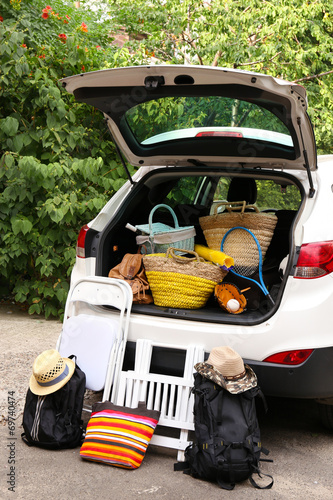 canvas print picture Suitcases and bags in trunk of car ready to depart for holidays