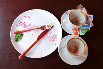 Dirty dishes on table after breakfast in cafe