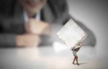 Woman carrying cube