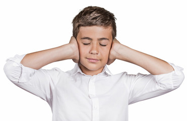 Boy covering ears with hands ignoring conversation