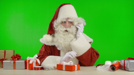 Santa Claus is Getting a Call on his Cell Phone - Bad News