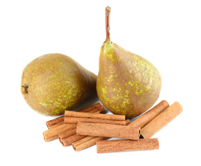 Ripe pears and cinnamon sticks isolated on white