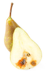 Rotten and fresh pears isolated on white