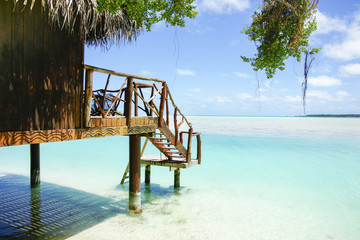 Tropical cabin over waters edge, Cook Islands