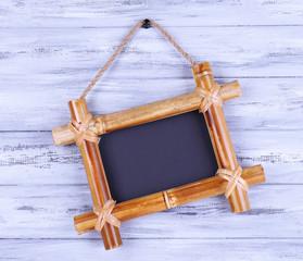 Rectangular chalkboard on wooden background