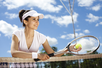 Female playing tennis on court