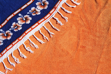 Summer background orange towel blue sarong