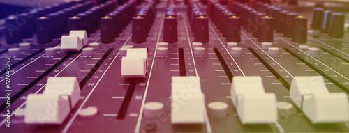 Leinwanddruck Bild Close-up of music controls buttons of studio mixer