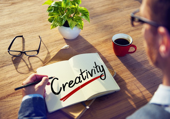 Businessman with Note About Creativity Concepts