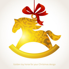 Golden Christmas toy with ribbons.