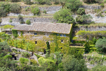 The old house on rock slope at Gordes city, Provence, France