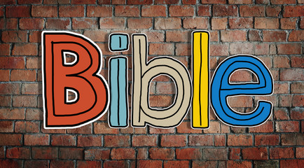 Bible and Brick Wall in the Background