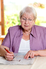 felame senior is solving crossword