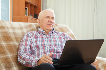 middle-aged man sitting on  couch