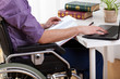 Disabled man studying at home