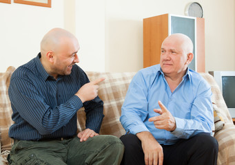 men talking   at home