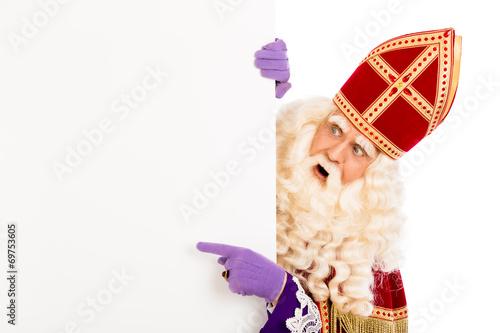 Leinwanddruck Bild Sinterklaas pointing on placard