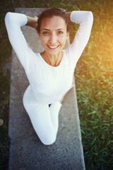 Portrait of a young woman performing yoga outdoors