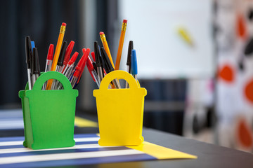 Stationery items in organizer at the table, copyspace