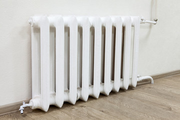 White iron radiator central heating in room