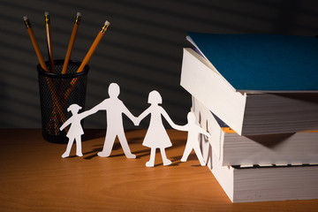 Desk with family in paper in night