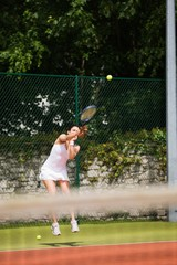 Pretty tennis player serving the ball
