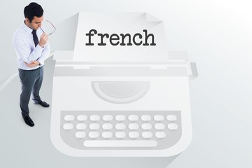The word french and unsmiling businessman holding glasses