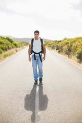 Hiking man walking on countryside road