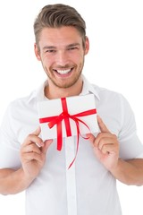 Portrait of smiling young man holding gift