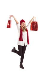 Pretty blonde carrying shopping bags