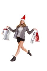 Festive blonde jumping with shopping bags
