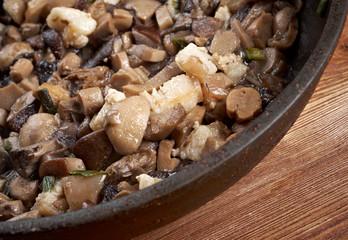 Delicious fried mushrooms in pan