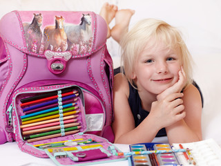 Cute child is proud to start at school