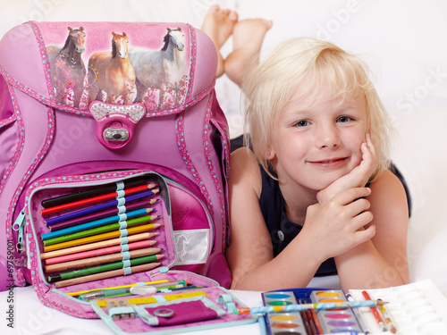 Cute child is proud to start at school - 69759001