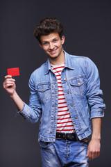 Denim man showing empty paper card