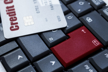 credit card on keyboard - e-commerce concept