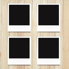 blank photo frame on wood background
