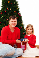 Portrait of happy family with Christmas gift