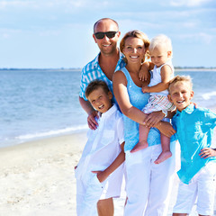 Happy smiling family with children standing.
