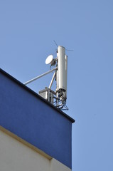 Cellular communication aerial on a building roof