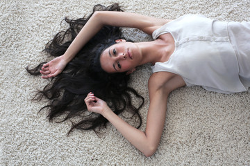 beautiful woman who is lying on the floor