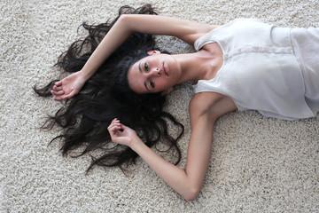 beautiful woman who is lying on the floor