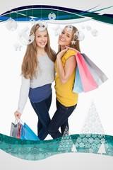 Two beautiful young women holding shopping bags