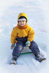 happy boy  on sled